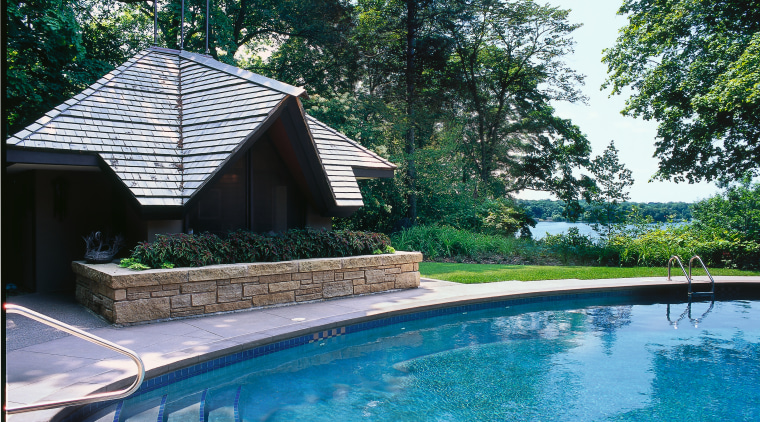View of this outdoor living area backyard, estate, home, house, leisure, outdoor structure, plant, property, real estate, resort, swimming pool, tree, water, teal, white