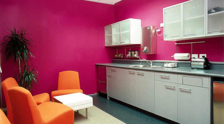 Office kitchen area with pink walls, orange armchairs, ceiling, interior design, office, wall, red