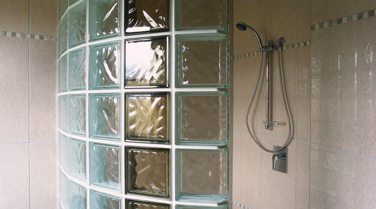 Glass blocks offer flexibility as you can arrange glass, plumbing fixture, shower, tile, wall, window, gray, brown