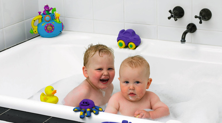 View of a bathtub with kids in it bathing, bathroom, bathtub, child, fun, infant, plumbing fixture, product, room, toddler, white