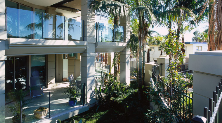exterior view of landscaping apartment, arecales, condominium, estate, home, house, palm tree, property, real estate, resort, tree, villa, window, black
