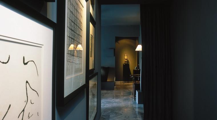 Hallway with large black and white prints, dark architecture, interior design, black