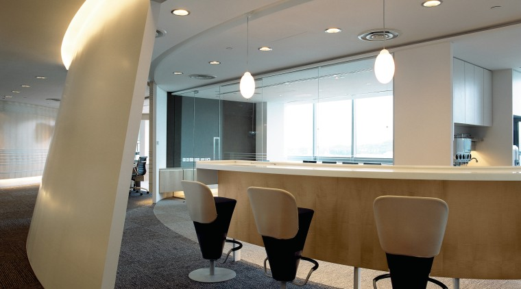 Office seating area with stool chairs at curved ceiling, conference hall, floor, furniture, interior design, lobby, office, table, gray, brown
