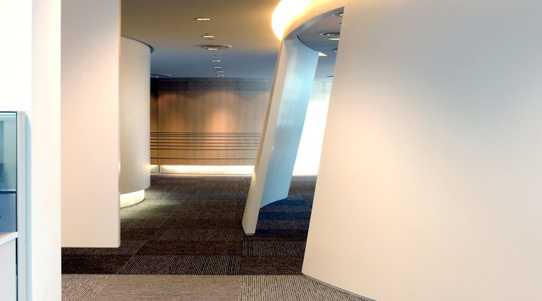 View of walkway through office boardered by sloping architecture, ceiling, daylighting, floor, flooring, interior design, property, real estate, white