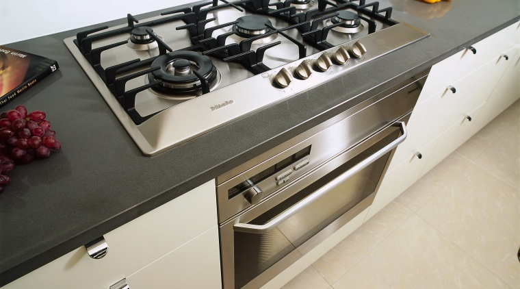 view of oven and cooktop countertop, gas stove, home appliance, kitchen, kitchen stove, gray