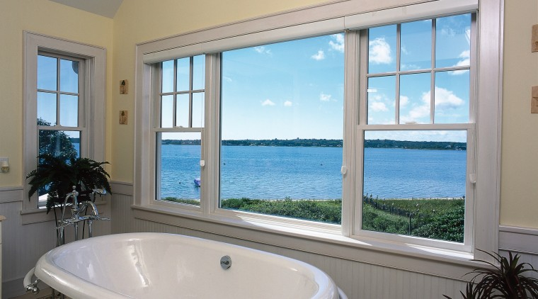 An interior view of bathroom and view outside bathroom, bathtub, daylighting, estate, home, interior design, property, real estate, room, window, gray