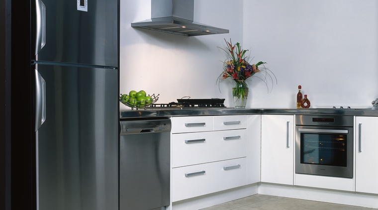 Kitchen with white cabinetry, stainless refrigerator, dishwasher, oven countertop, cuisine classique, home appliance, kitchen, kitchen appliance, kitchen stove, major appliance, product design, refrigerator, gray, black
