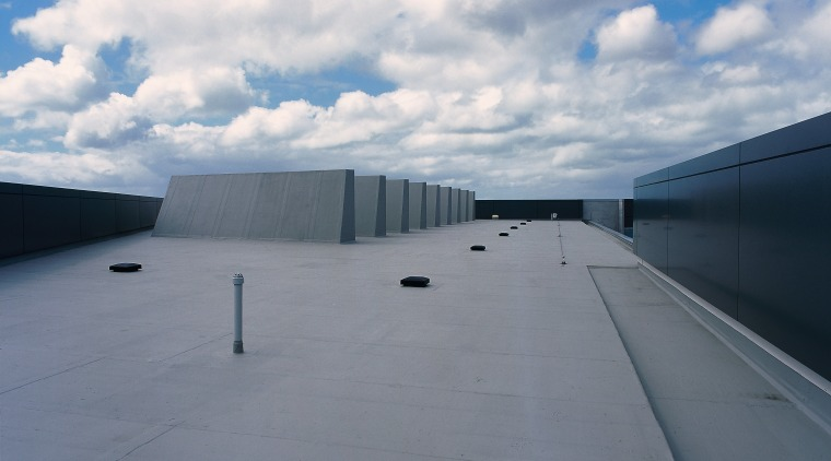 Waterproof roofing has been used on this section architecture, asphalt, cloud, daylighting, daytime, fixed link, horizon, infrastructure, line, road, road surface, roof, sky, sunlight, gray