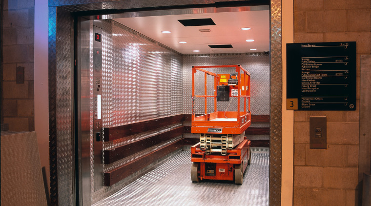 Service lift with heavy gauge aluminium chequer plates door, brown