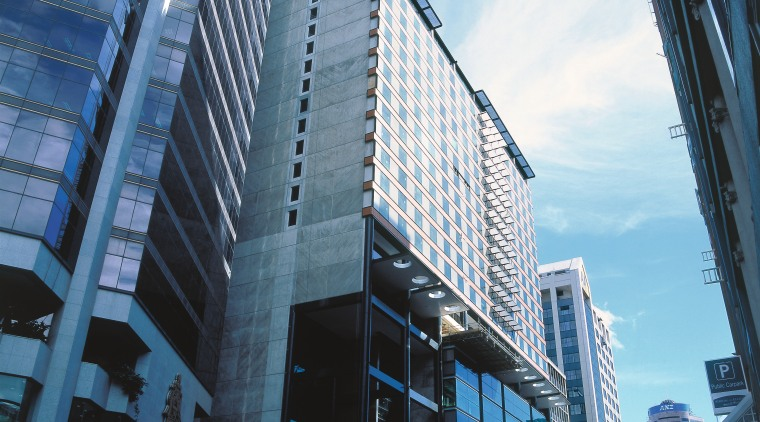 Exterior view of Sky City Convention centre showing architecture, building, city, cityscape, commercial building, condominium, corporate headquarters, daytime, downtown, facade, headquarters, metropolis, metropolitan area, mixed use, reflection, sky, skyline, skyscraper, tower block, urban area, window, teal, black