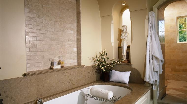 Large bath with limestone surround, brick lined archway, bathroom, bathtub, ceiling, countertop, estate, floor, flooring, home, interior design, room, sink, brown