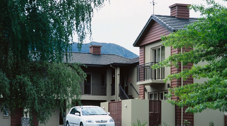 Exterior view of motor lodge with grey roofing architecture, building, car, cottage, estate, facade, home, house, mansion, neighbourhood, plant, property, real estate, residential area, roof, suburb, tree