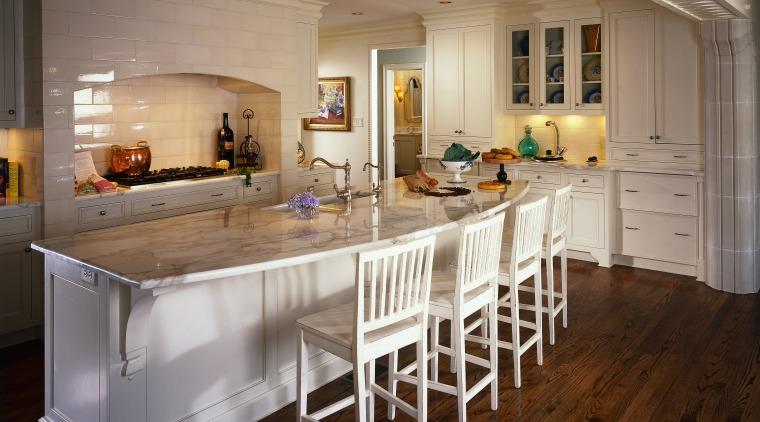 View of the kitchen area, wooden flooring, wooden cabinetry, countertop, cuisine classique, floor, flooring, hardwood, interior design, kitchen, room, table, wood flooring, brown, gray