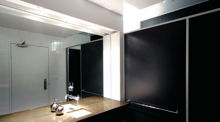 View of the bathroom, mirror, wooden vanity, black architecture, ceiling, glass, interior design, light fixture, lighting, product design, black, gray