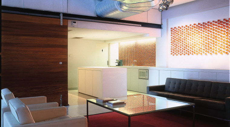 View of the setting area, polished concrete flooring, architecture, ceiling, daylighting, furniture, interior design, lobby, table, red