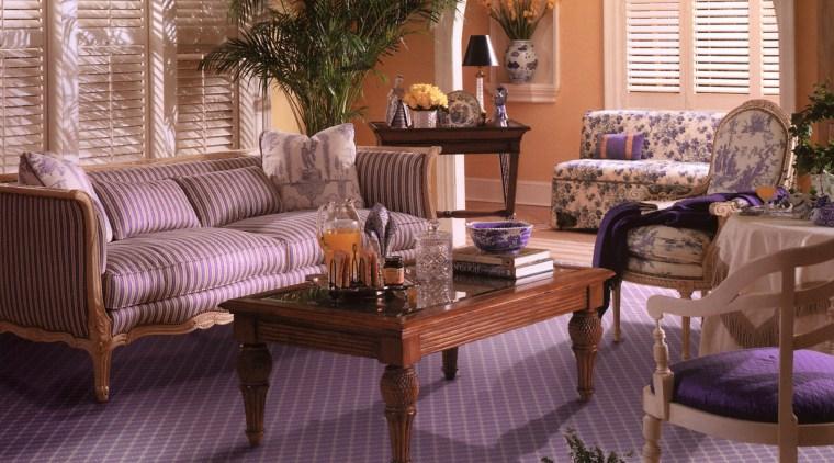 View of a living area, lavender coloured patterned floor, flooring, furniture, hardwood, home, interior design, living room, room, table, wood, brown