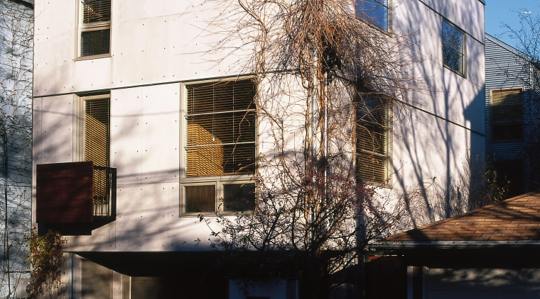 Exterior view of a white cubic house, many apartment, architecture, building, facade, home, house, neighbourhood, real estate, reflection, residential area, sky, wall, window, black
