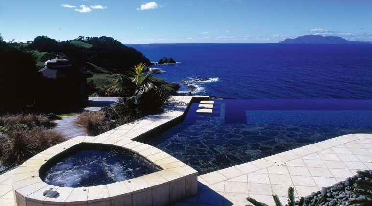 View of a spa and swimming pool on estate, property, sea, sky, swimming pool, water, blue