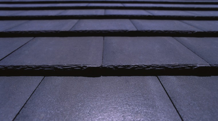 Closeup of Monier shingle roof tiles in dark asphalt, daylighting, horizon, light, line, road surface, roof, sky, sunlight, blue