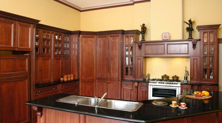 view of the black assoluto granite benchtop cabinetry, countertop, cuisine classique, hardwood, interior design, kitchen, real estate, room, red, orange