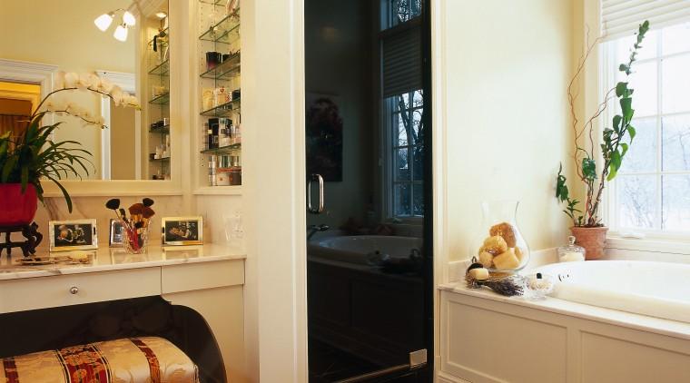 Bathroom with cream walls, timber flooring, white bath, interior design, room, window, orange