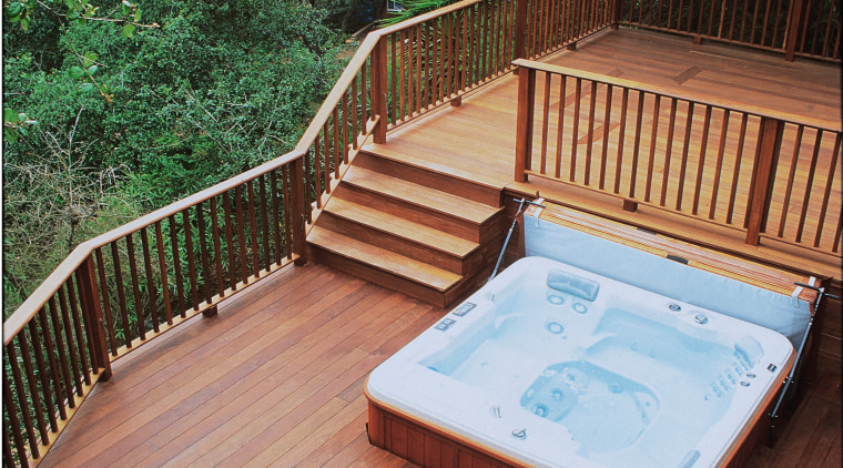 Exterior view of a large spa pool on backyard, deck, floor, hardwood, outdoor structure, swimming pool, wood, wood stain, red
