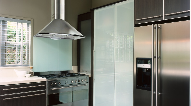 view of the kitchen and rangehood cabinetry, countertop, home appliance, interior design, kitchen, real estate, room, gray, black