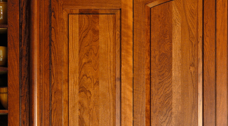 Close up view of some wooden cabinetry. cabinetry, cupboard, door, furniture, hardwood, wood, wood stain, brown
