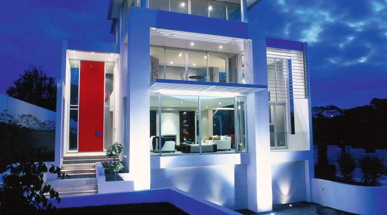 view of the house showing a red double architecture, elevation, estate, facade, home, house, interior design, lighting, majorelle blue, property, real estate, sky, villa, blue