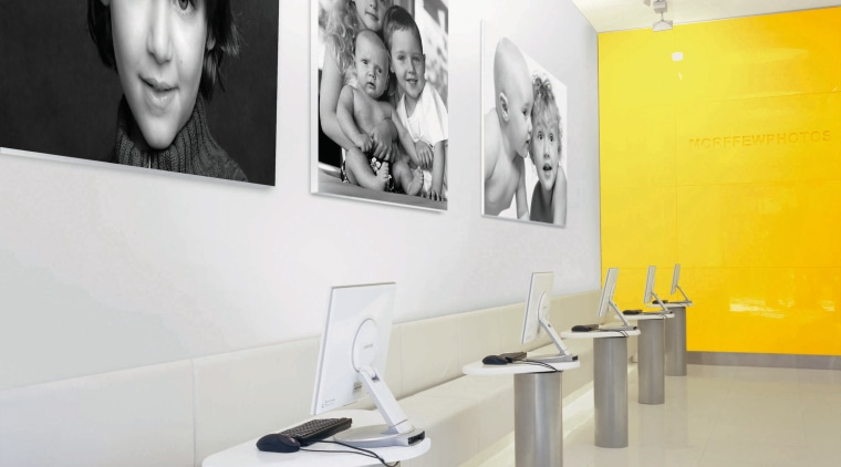 View of a showroom, white tiled floor, yellow ceiling, floor, furniture, interior design, product design, table, tap, wall, white