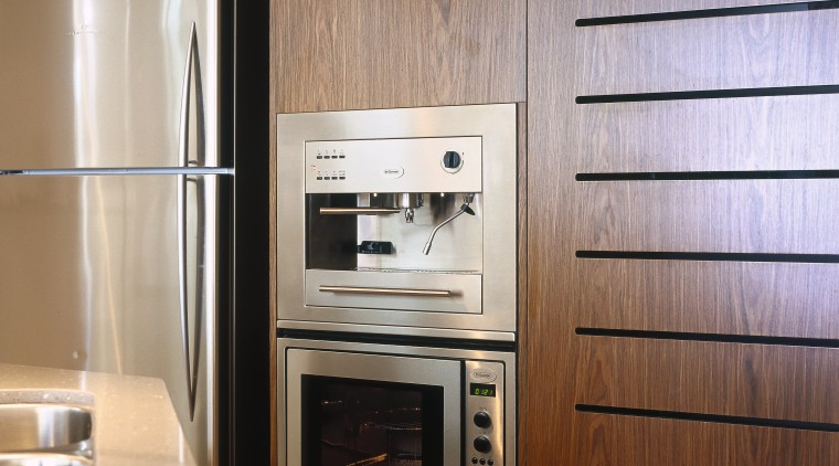 view of the stainless steel kleenmaid microwave and cabinetry, countertop, home appliance, kitchen, kitchen appliance, major appliance, microwave oven, brown, gray
