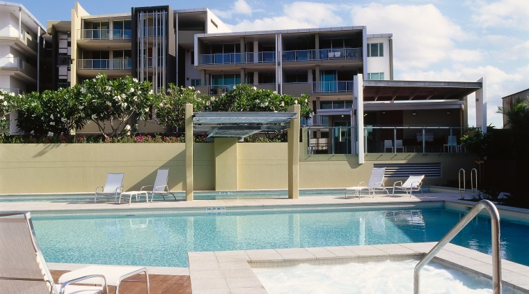 view of the recreation pool area apartment, condominium, estate, home, hotel, house, property, real estate, residential area, resort, swimming pool, villa, white