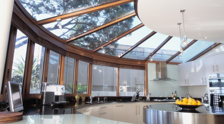 Circular shaped kitchen with windows and overhead glazing. ceiling, daylighting, interior design, real estate, roof, window, white, gray