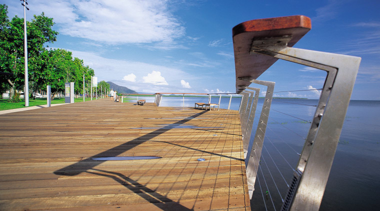 A close up view of the wooden and boardwalk, cloud, fixed link, horizon, sea, sky, walkway, water, teal