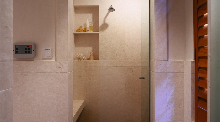 view of the shower stall that also doubles bathroom, ceiling, floor, flooring, interior design, plumbing fixture, room, tile, wall, brown, gray