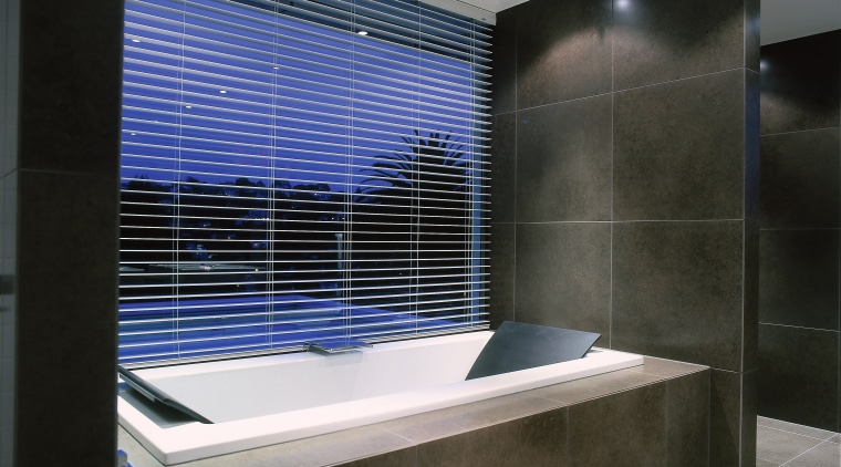 Image of a bathroom featuring plumbing work. architecture, bathroom, daylighting, glass, interior design, tile, black, gray