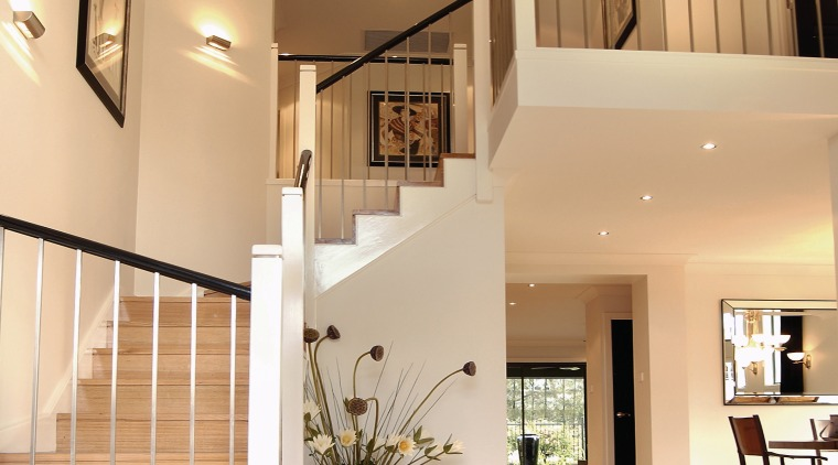 A view of a staircase, cream tiled floor, architecture, ceiling, daylighting, estate, floor, flooring, handrail, hardwood, home, house, interior design, living room, lobby, property, real estate, stairs, wood flooring, orange