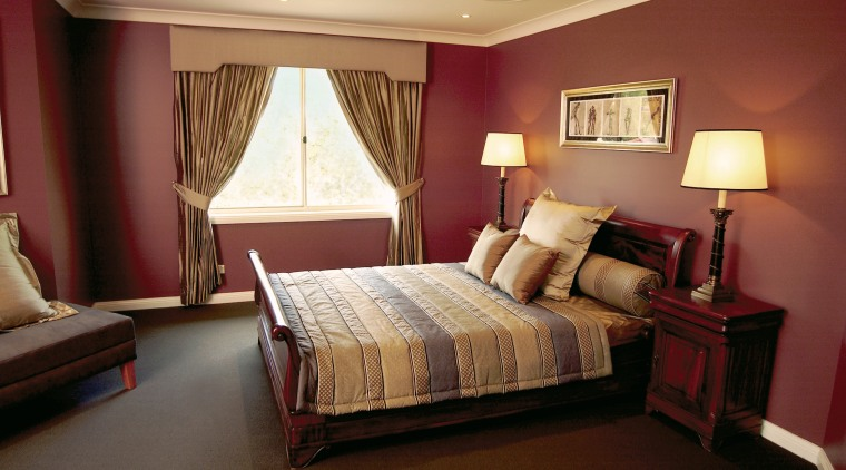 A view of a bedroom, red walls, brown bed frame, bedroom, ceiling, furniture, home, interior design, property, real estate, room, suite, wall, red, brown