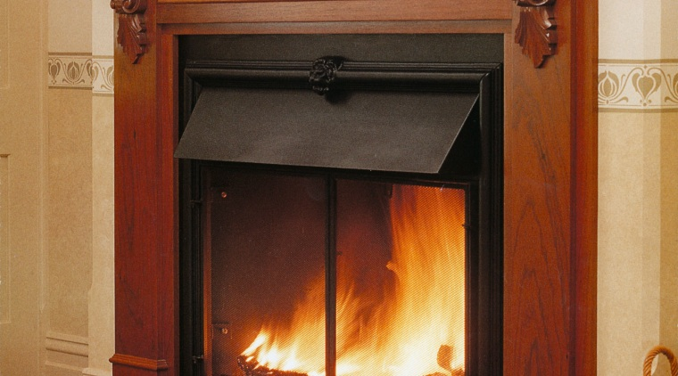 A view of a wooden fireplace surrounded with fire screen, fireplace, hearth, heat, home appliance, wood burning stove, brown