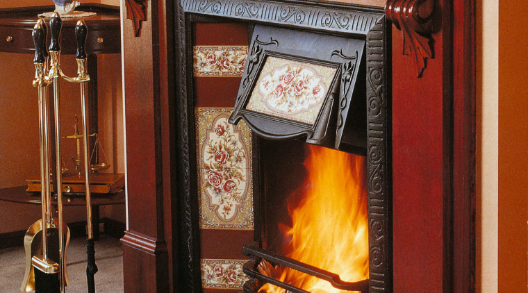 A view of a wooden and floral fireplace fire screen, fireplace, hearth, heat, wood burning stove, red