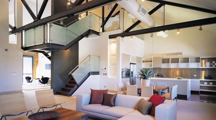 A view of a living area, cream carpet, ceiling, home, interior design, living room, loft, gray