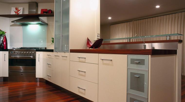 A view of a kitchen area, wooden flooring cabinetry, countertop, cuisine classique, floor, flooring, hardwood, interior design, kitchen, laminate flooring, room, wood flooring, brown, gray