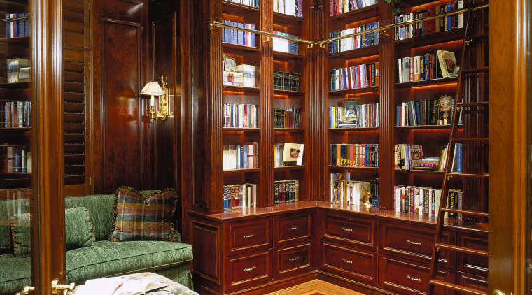 view of the study with a stained dark bookcase, flooring, furniture, institution, interior design, library, lobby, public library, shelving, red