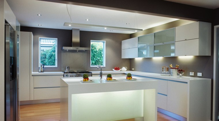 A view of a kitchen, wooden flooring, white cabinetry, ceiling, countertop, floor, flooring, hardwood, interior design, kitchen, real estate, room, gray