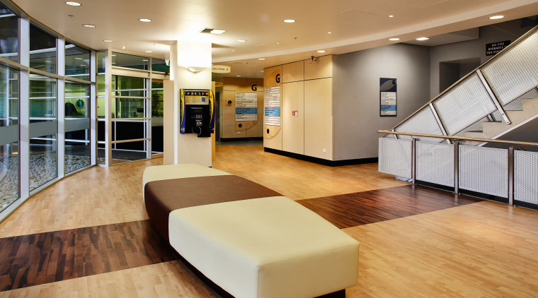 Lobby area of hospital with two toned flooring ceiling, floor, flooring, interior design, lobby, orange