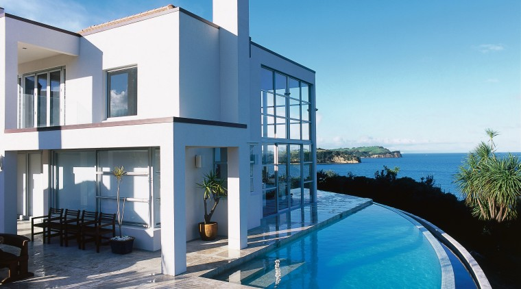 Exterior view of white two storey house, curved apartment, architecture, building, condominium, estate, home, house, property, real estate, sky, swimming pool, villa, teal