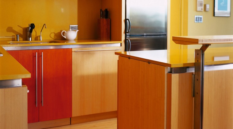 A view of a kitchen, wooden flooring and cabinetry, countertop, floor, flooring, hardwood, interior design, kitchen, room, wood, wood flooring, brown, orange