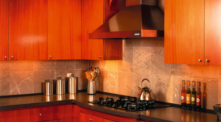 A view of a kitchen, wooden cabinetry and cabinetry, ceiling, countertop, cuisine classique, floor, flooring, hardwood, home, interior design, kitchen, lighting, orange, property, room, under cabinet lighting, wall, wood, wood flooring, red
