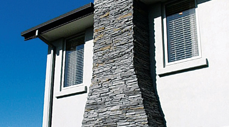 view of the stone veneers  that are architecture, building, chimney, facade, home, house, roof, sky, wall, window, blue, white