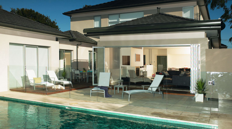 An exterior view of the pool and patio estate, facade, home, house, property, real estate, roof, swimming pool, villa, window